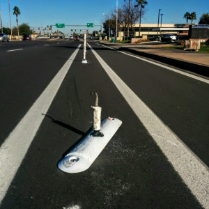 Car hits Tempe bike barricade